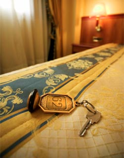 Hotel bed and key